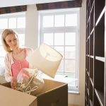 Woman Packing Fragile Lamp