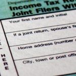 Close up of tax forms that no longer include tax deductions for moving expenses