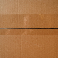 A cardboard box top with tape to illustrate moving company west linn oregon