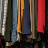 Jackets, shirts, etc. hanging from a closet rod to illustrate moving company west linn oregon