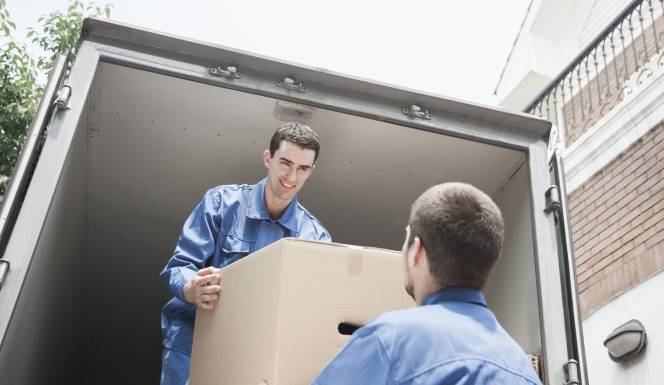 man handing a box to another man