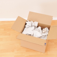 Packing Box in Empty Room to illustrate moving company forest grove oregon