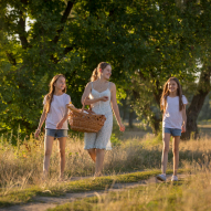 Happy family walking at meadow to picnic to illustrate moving company forest grove oregon