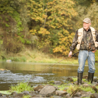 an older man fishes in the tualatin river in west linn to illustrate moving company west linn oregon