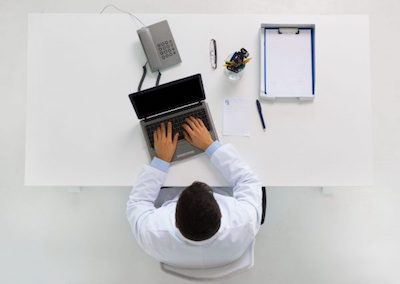 Overhead photo of a man working at his office desk