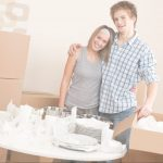 A young couple packing dishes for a move